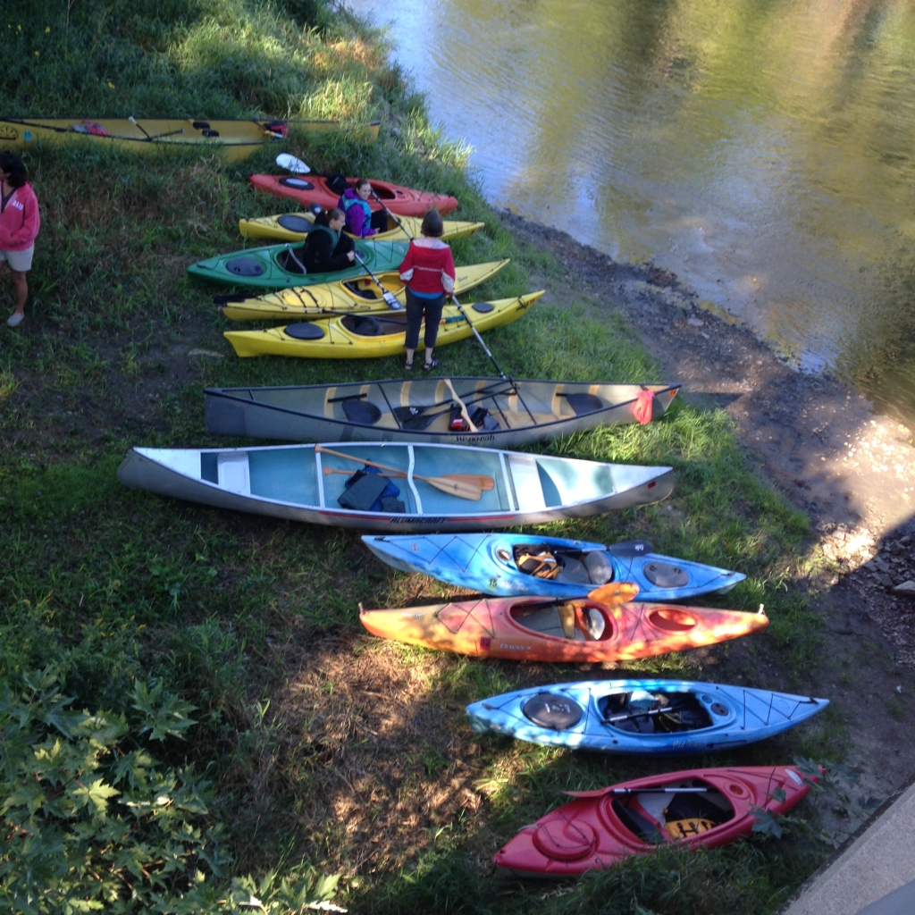 Kayaks pulled on the banks of the Cannon River