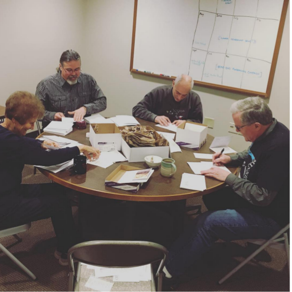 Volunteers addressing letters at the office